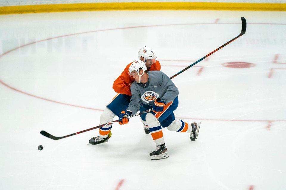 New York Islanders defenseman Scott Mayfield (24) defends