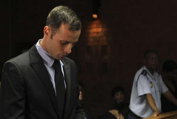Olympic athlete Oscar Pistorius stands inside the court