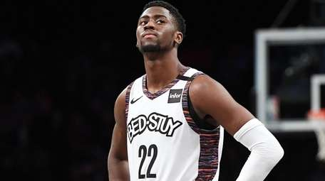 Nets guard Caris LeVert looks on in the