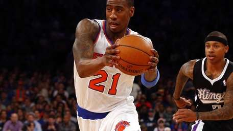 Iman Shumpert drives to the basket in action