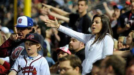 Braves fans do the tomahawk chop during the