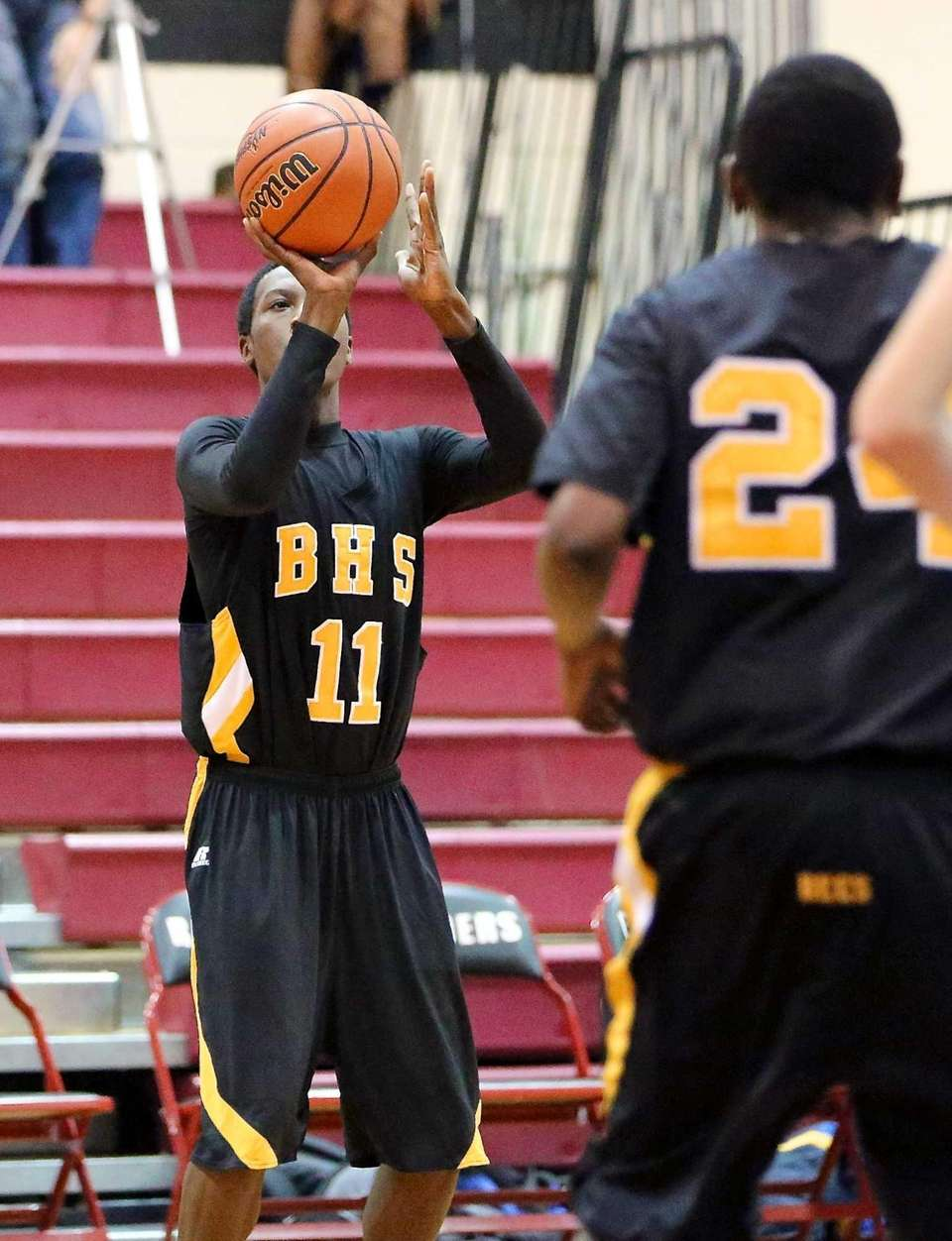 Bridgehampton's Jerome Walker drains a three pointer against