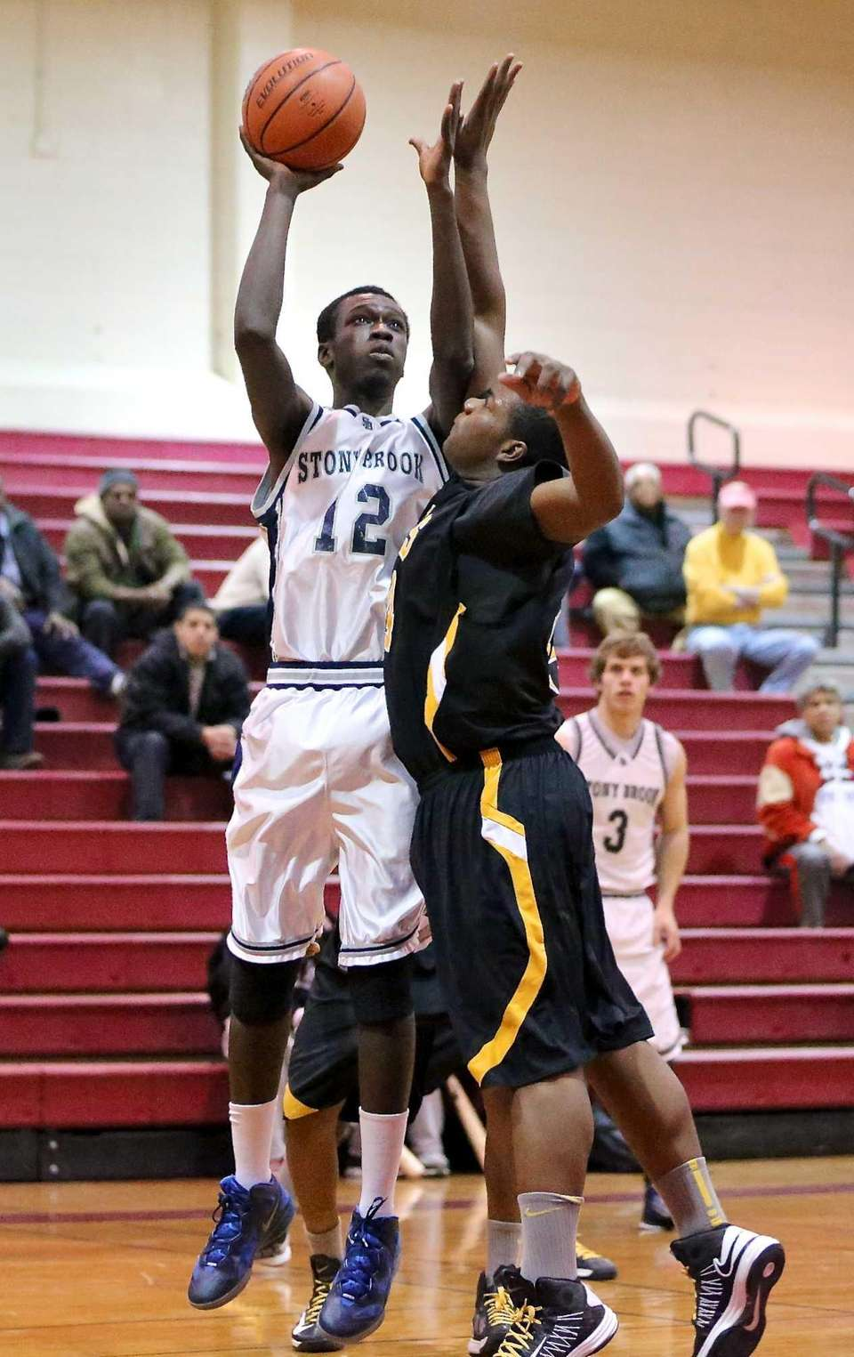 Stony Brook's Michael Dingammadji gets fouled on the