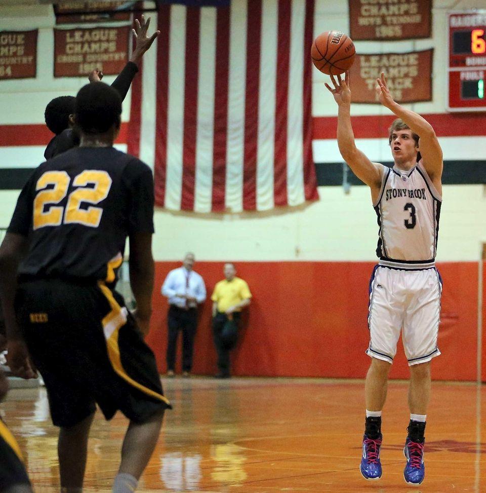 Stony Brook's Tyler Abrahamsen tries for the three