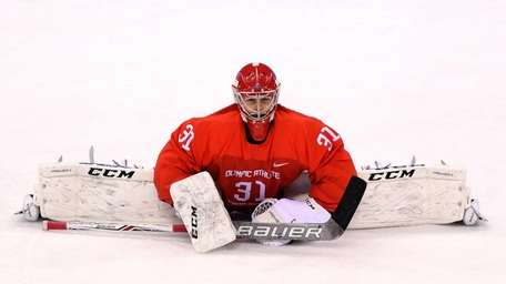Ilya Sorokin warms up before the men's ice