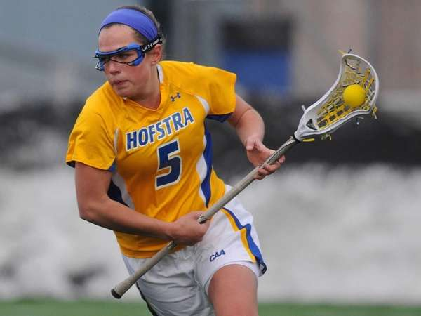 Hofstra's Brittain Altomare carries behind the net during