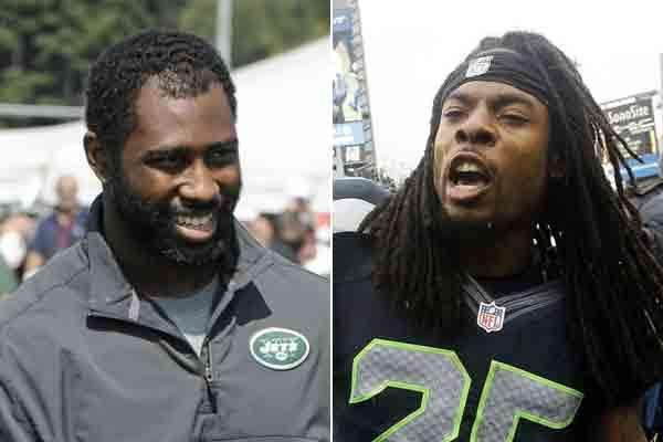 Jets cornerback Darrelle Revis, left, and Seattle Seahawks