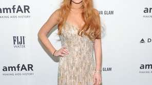 Lindsay Lohan attends amfAR's New York gala at