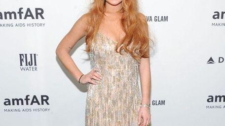 Lindsay Lohan attends amfAR's New York gala at