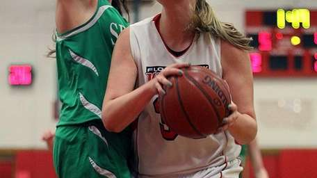 Floral Park's Lorraine Hickman goes up against Seaford's