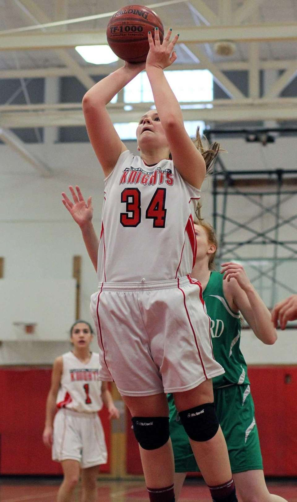 Floral Park's Lorraine Hickman shoots up the middle.