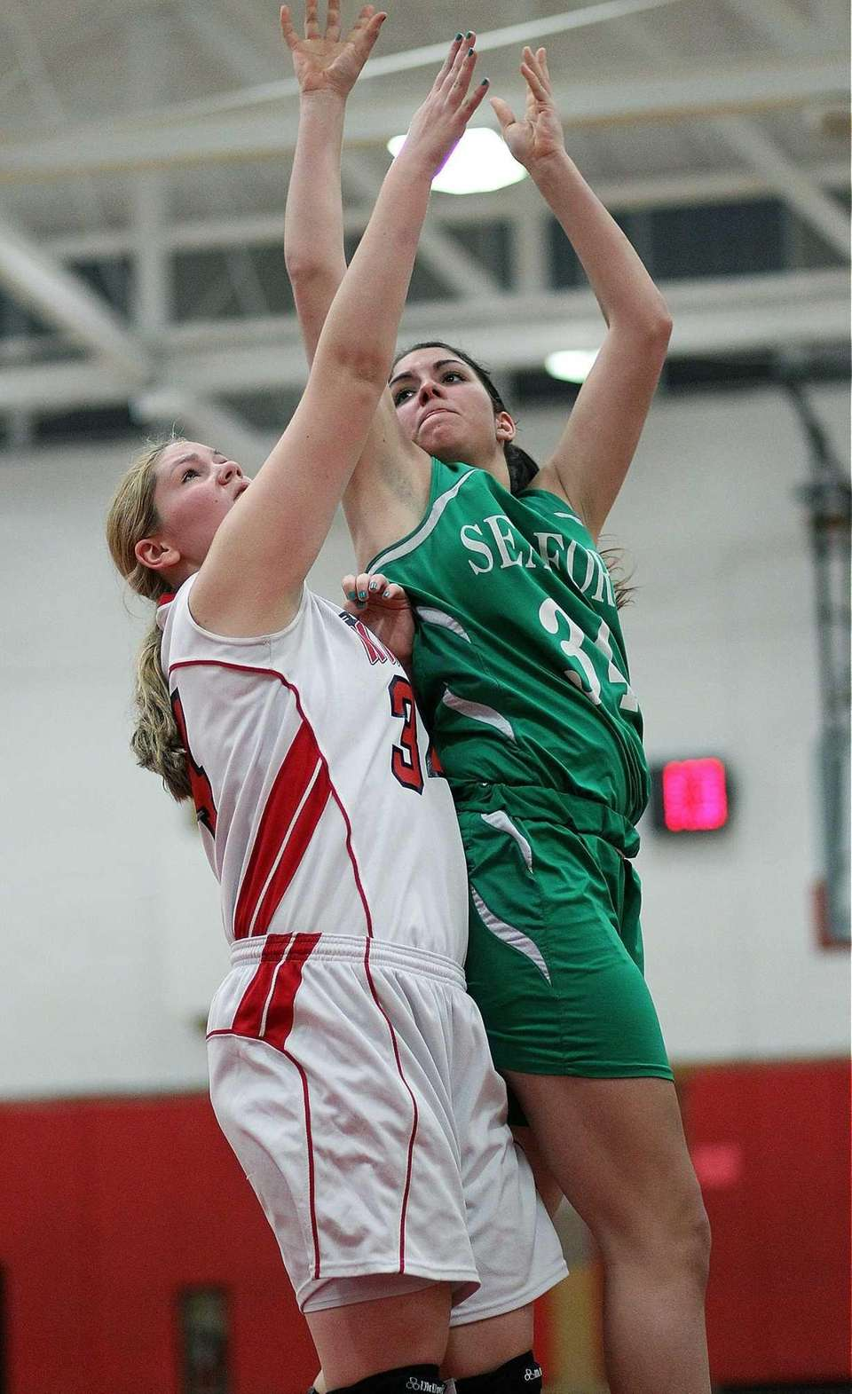 Floral Park's Lorraine Hickman defends against Seaford's Jessica