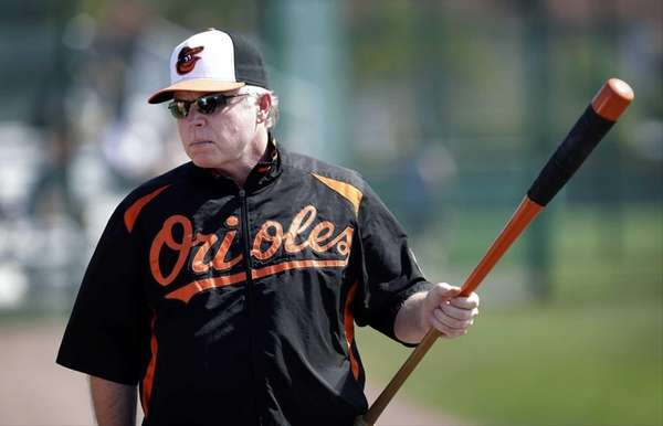 Baltimore Orioles manager Buck Showalter holds a bat