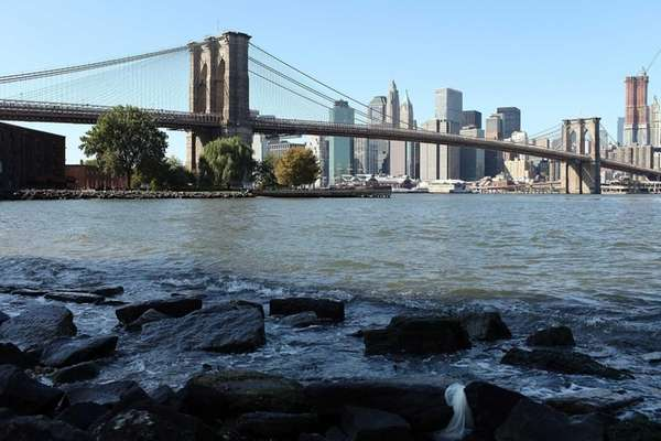 The Brooklyn Bridge is viewed from the shore