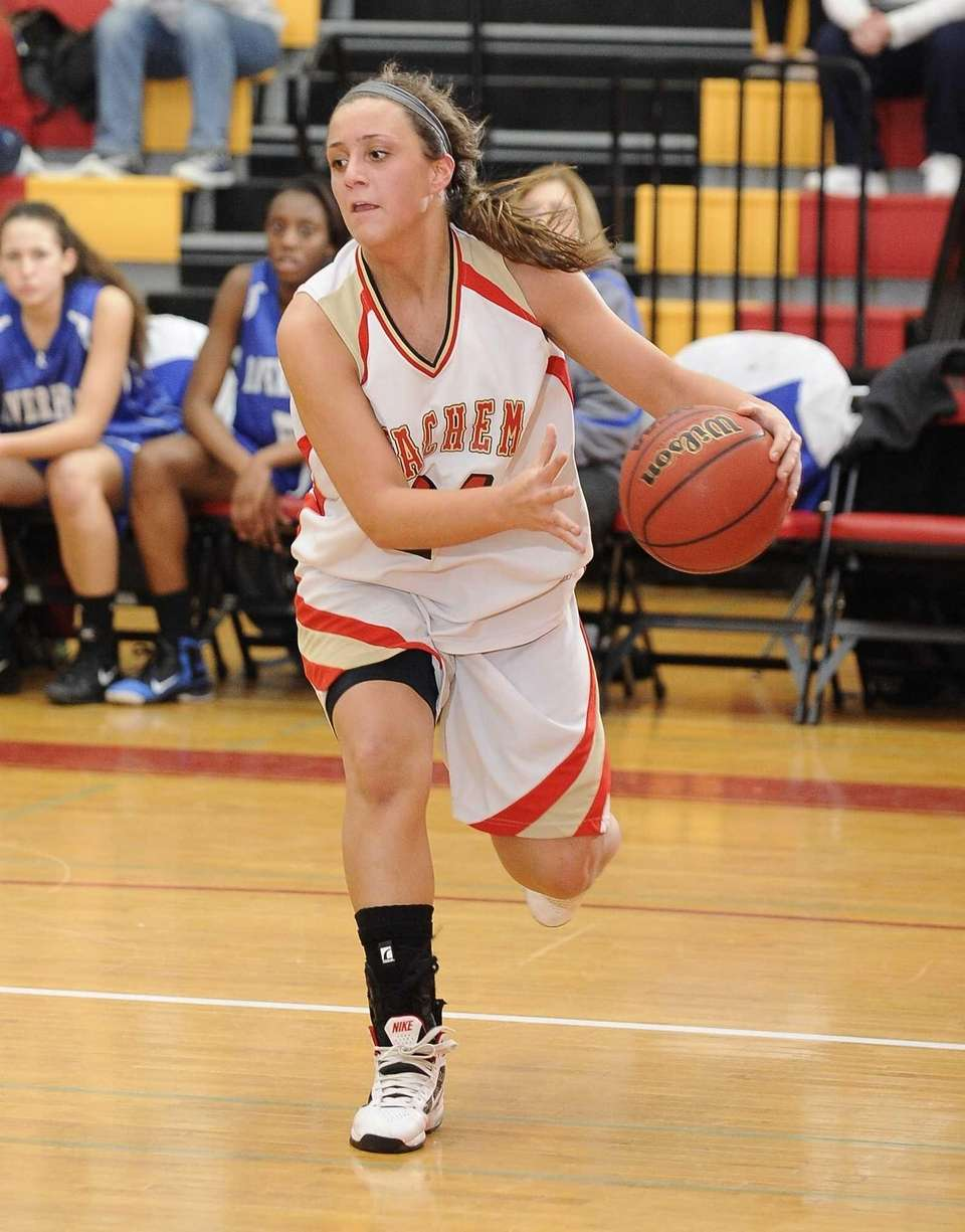 Sachem East's Emily Carmel drives into the key