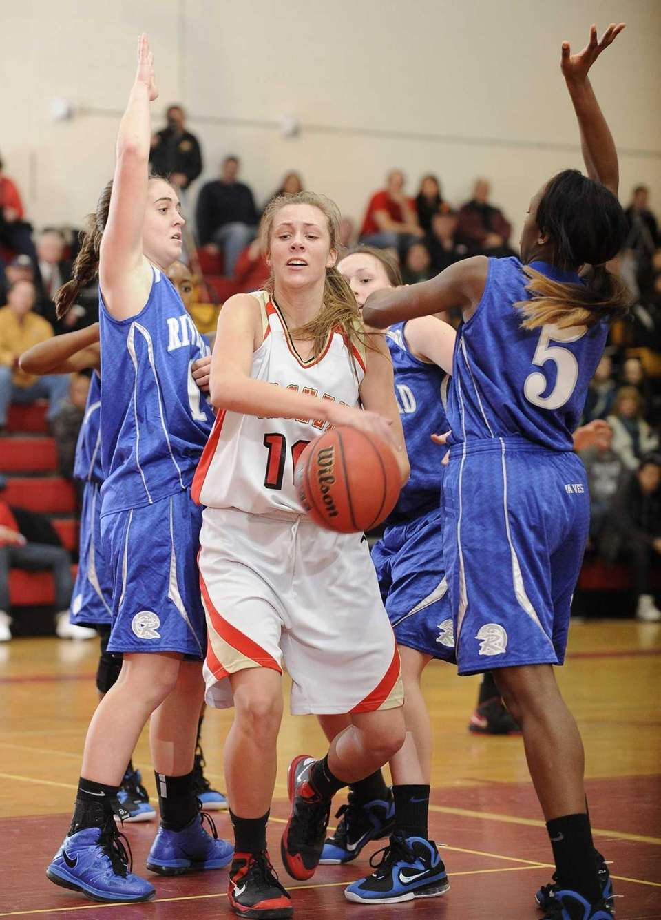 Sachem East's Kathleen Everson splits Riverhead defenders Sam