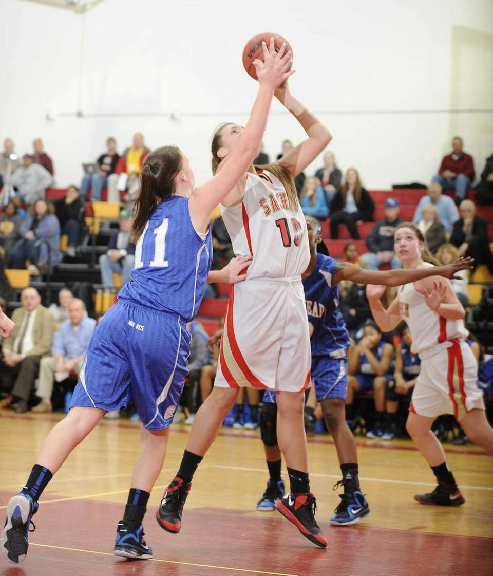 Sachem East's Kathleen Everson shoots from under the