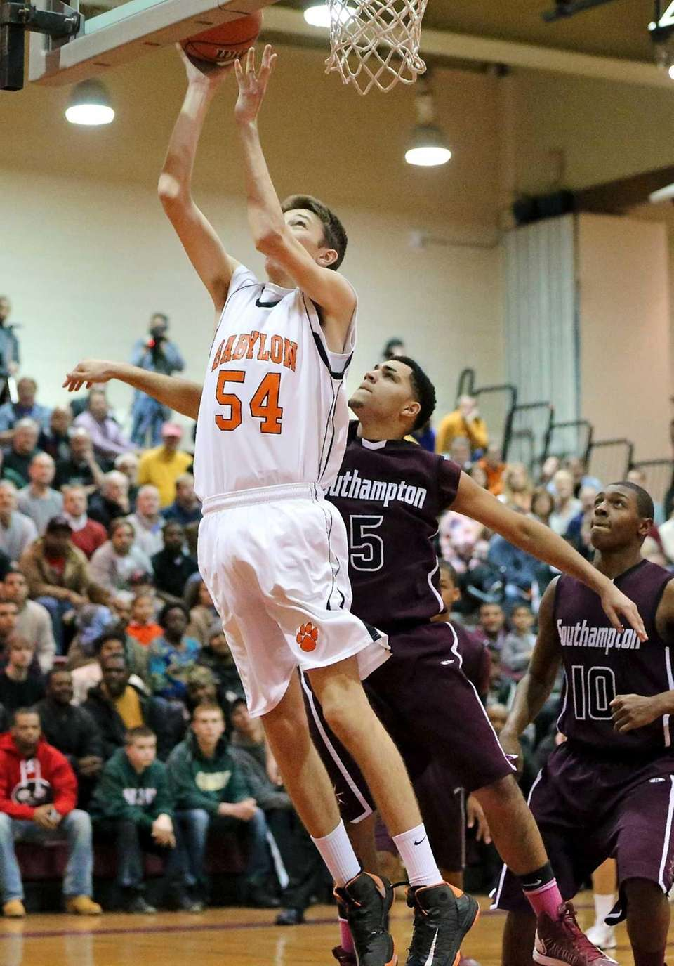 Babylon's Brendan Laing puts in the rebound past