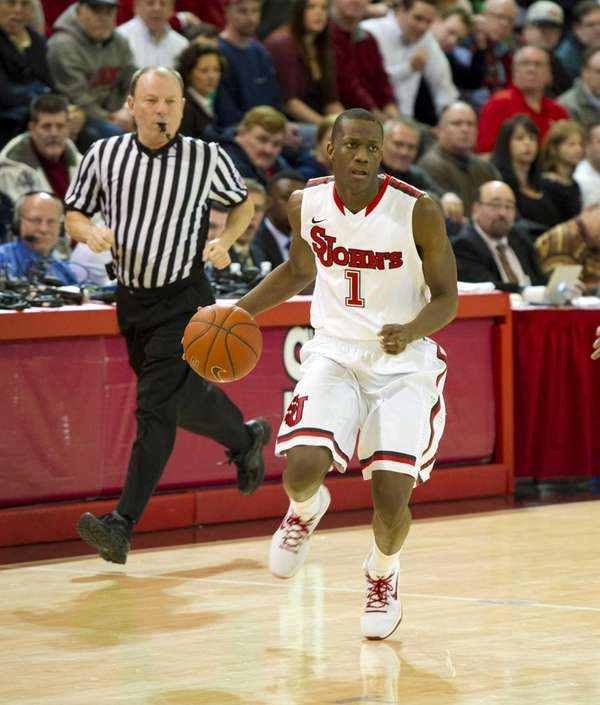 Phil Greene of St. John's dribbles the ball