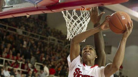 Amir Garrett of St. John's avoids the block