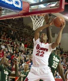 Amir Garrett of St. John's avoids the block