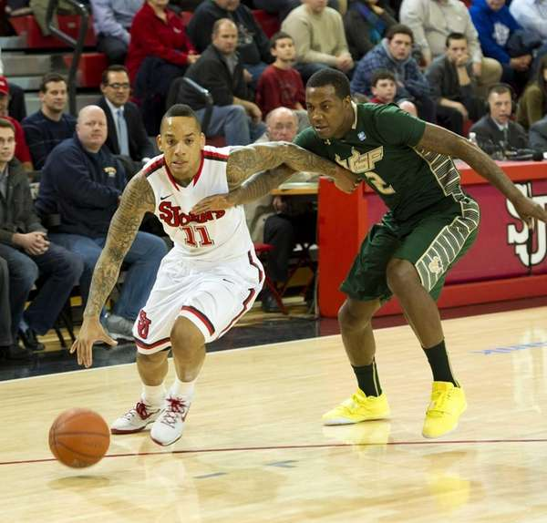 D'Angelo Harrison of St. John's dribbles away from