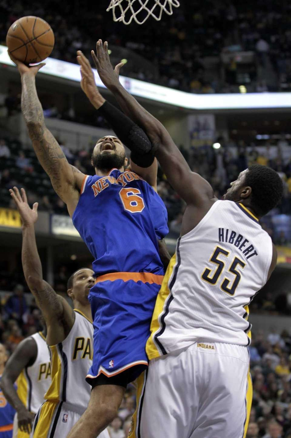Knicks center Tyson Chandler, left, shoots around Indiana