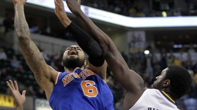 Knicks center Tyson Chandler, left, shoots around Indiana