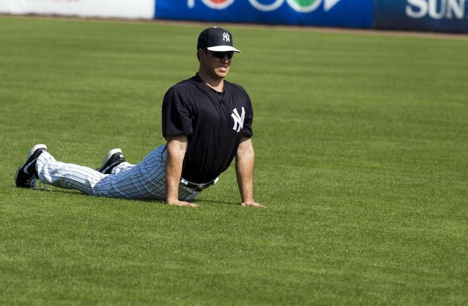 Yankees' Mark Teixeira stretches while warming up for