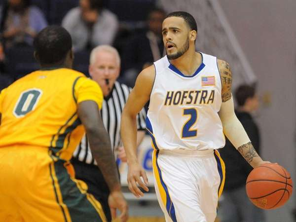 Hofstra's Taran Buie, right, looks to pass as