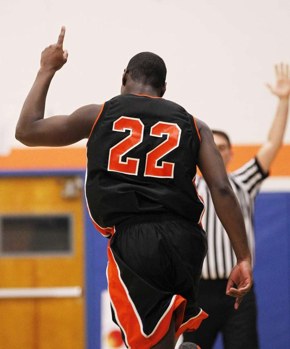 Terrance Danns of Hicksville celebrates after hitting a