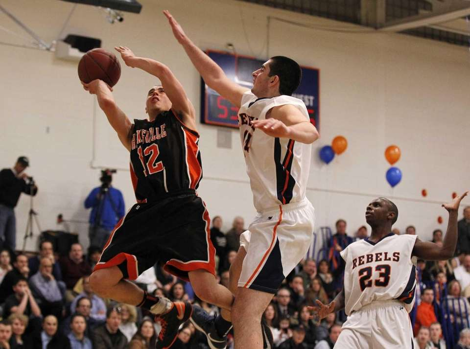 Nicholas Petrucelli of Hicksville drives to the net