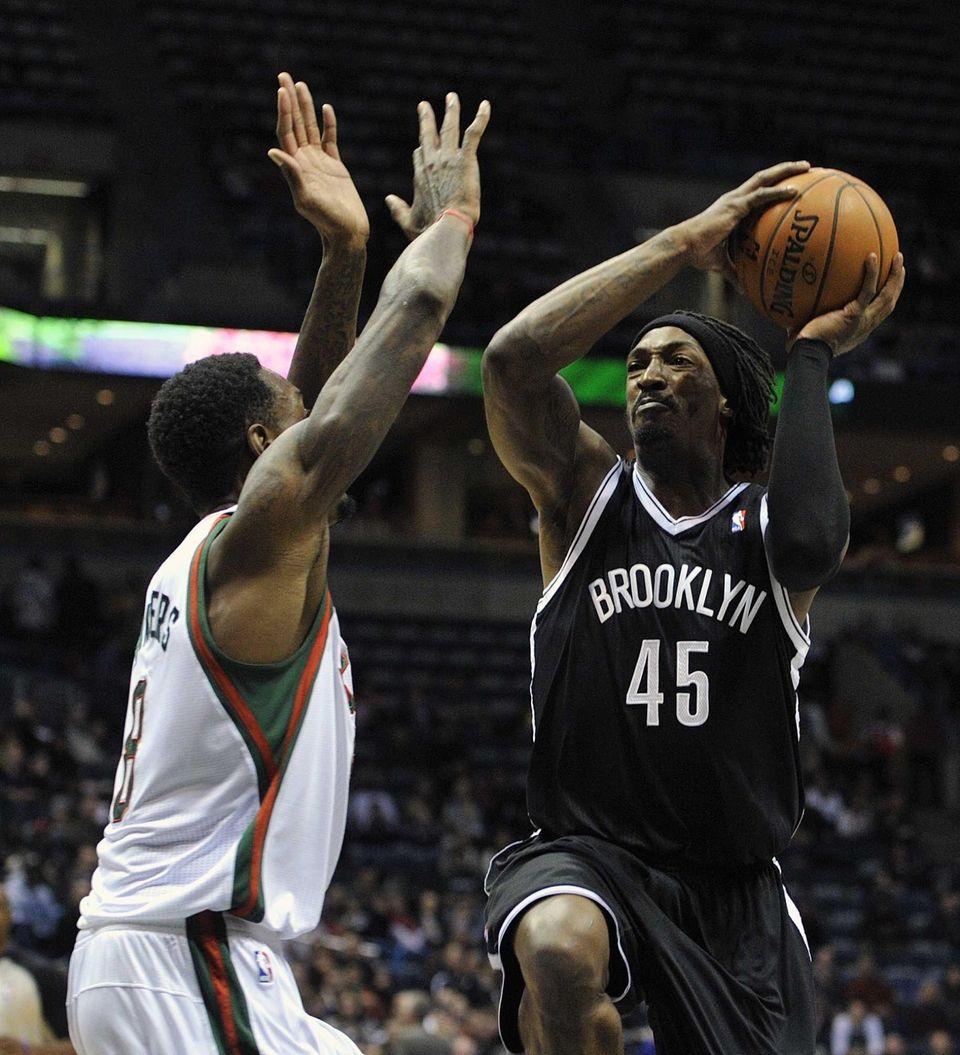 Milwaukee Bucks' Larry Sanders left, defends as Brooklyn