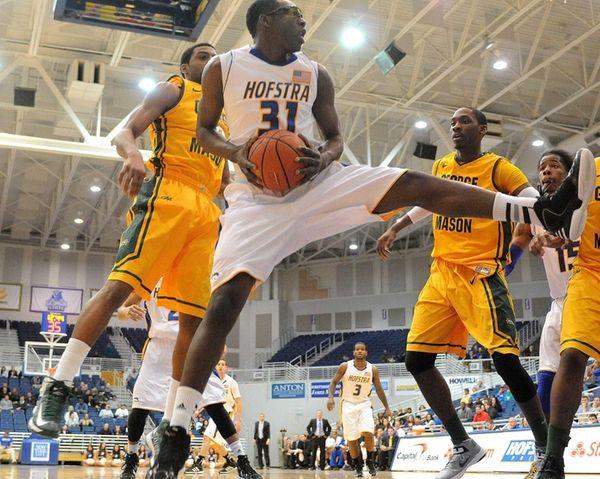 Hofstra's Moussa Kone pulls down a rebound in