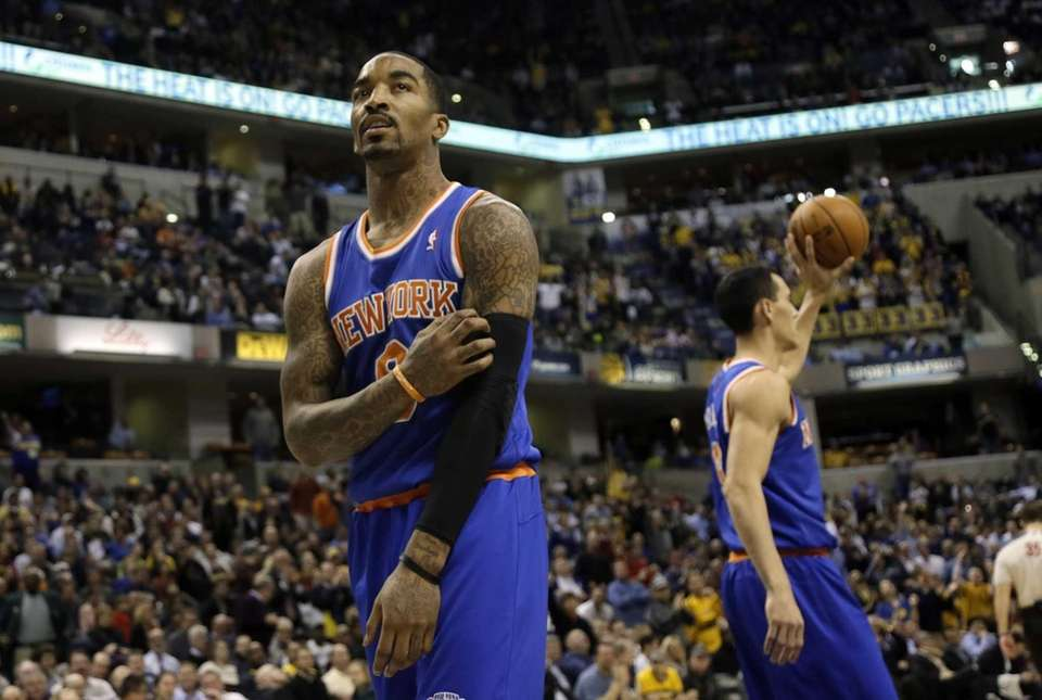Knicks guard J.R. Smith looks at the scoreboard