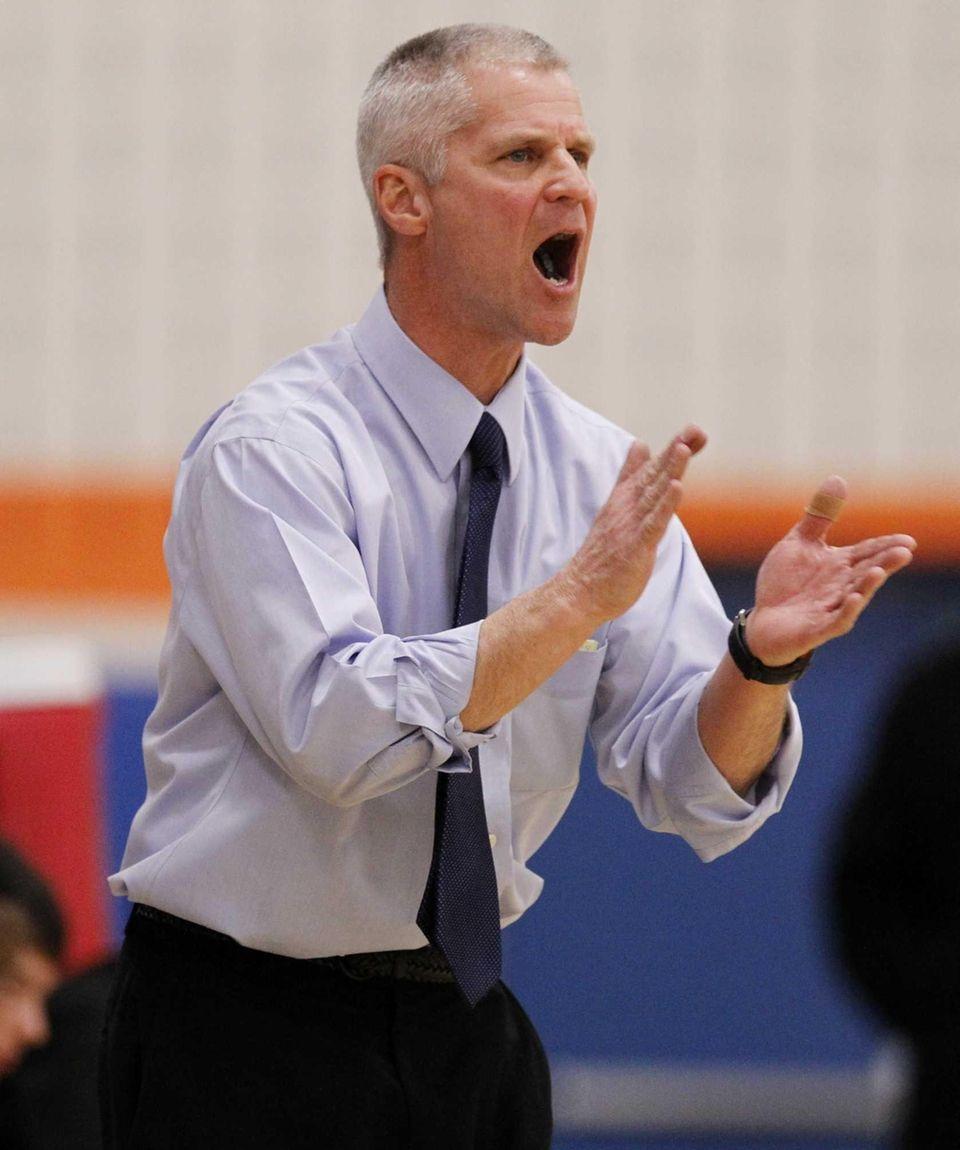 Coach Phil Essigman of Hicksville cheers on his