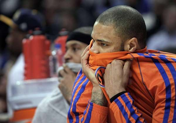 Knicks center Tyson Chandler watches from the bench