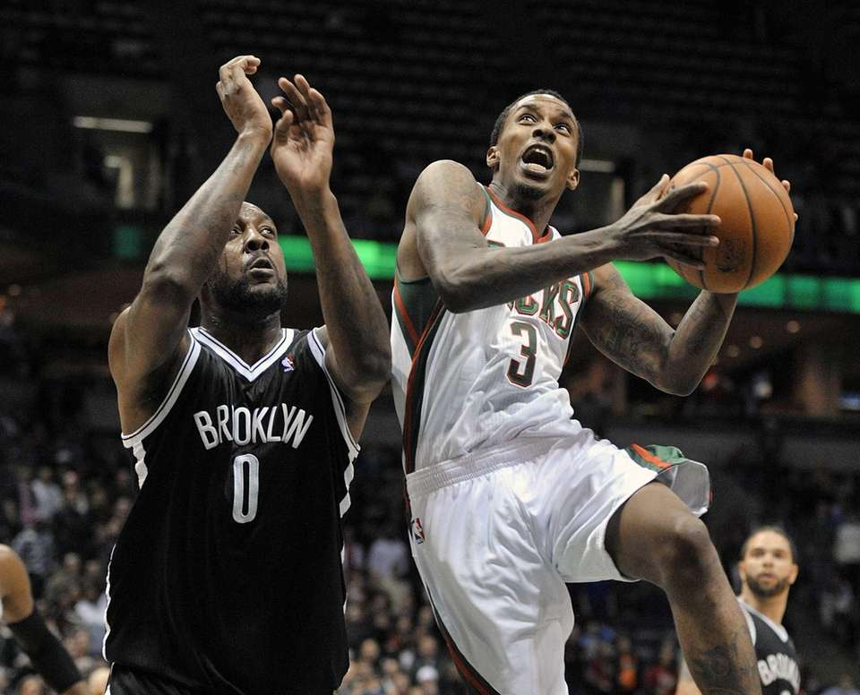 Brooklyn Nets' Andray Blatche defends as the Milwaukee