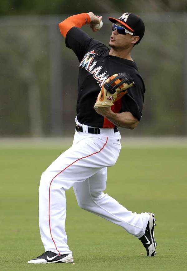 Miami Marlins right fielder Giancarlo Stanton throws during