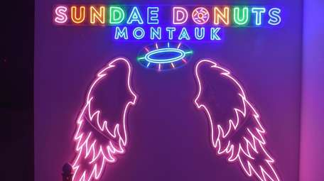 The neon sign advertising Sundae Donuts Montauk, which
