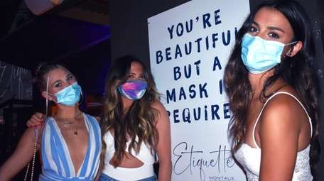 A trio of masked guests at Etiquette Montauk