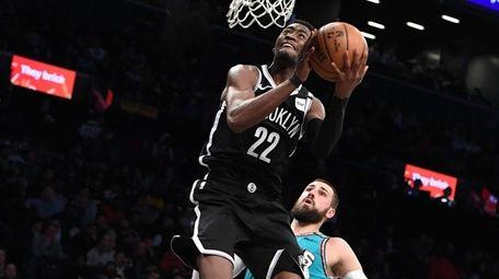 Brooklyn Nets guard Caris LeVert scores a layup