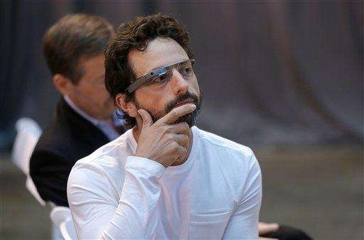 Google co-rounder Sergey Brin wears Google Glass glasses
