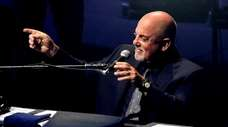 Billy Joel performs before a sold-out crowd at