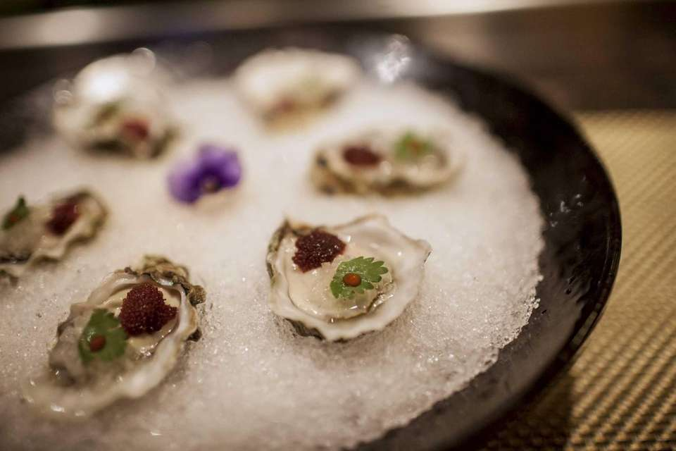 Oysters on the half shell are garnished with