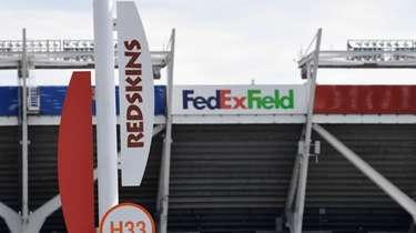 Signs for the Washington Redskins are displayed outside
