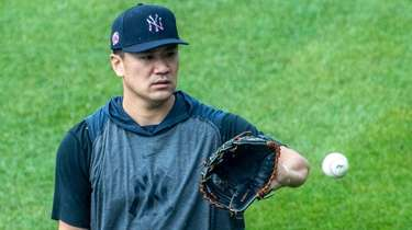 Yankees' pitcher Masahiro Tanaka #19 warning up in