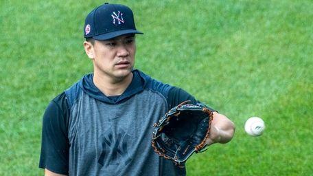Yankees' pitcher Masahiro Tanaka #19 warning up in
