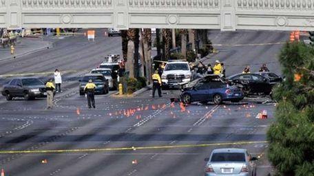 Las Vegas Metropolitan Police officers investigate the scene