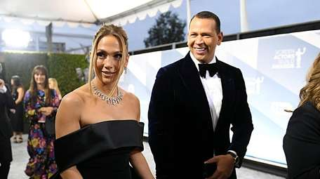 Jennifer Lopez and Alex Rodriguez attend the 26th
